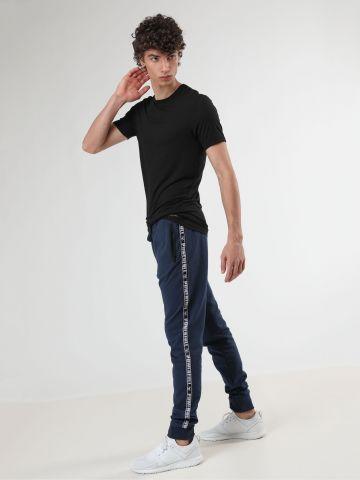 מכנסי טרנינג עם סטריפים בצדדים Powerfull