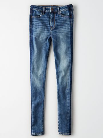 ג'ינס סקיני בשטיפה בהירה עם שפשופים Skinny / נשים