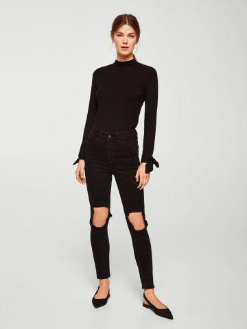 ג'ינס סקיני בגזרה גבוהה עם קרעים