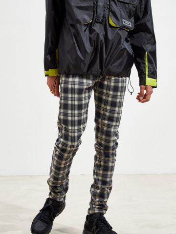 מכנסי סקיני בהדפס משבצות UO