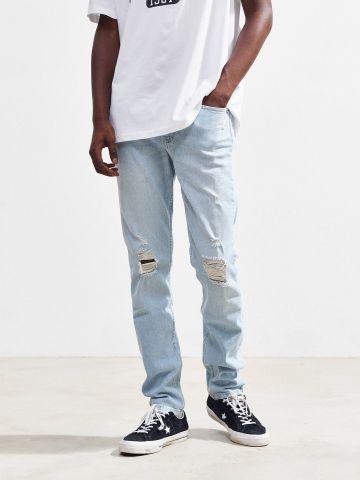 ג'ינס סקיני בשטיפה בהירה עם קרעים BDG