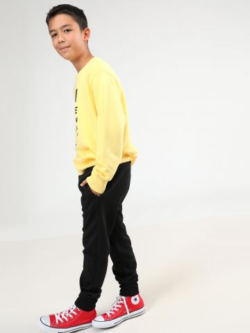 מכנסי טרנינג עם כיסי רוכסן