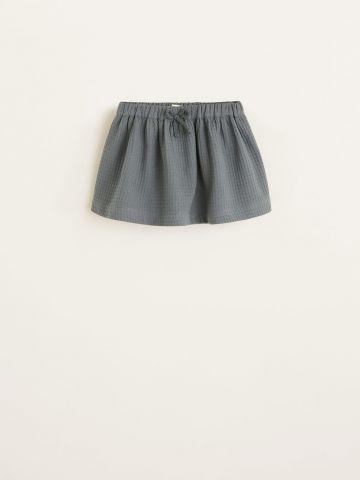 חצאית מיני בטקסטורת פיקה / בייבי בנות