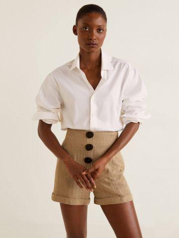 מכנסי פשתן בגזרה גבוהה עם כפתורים