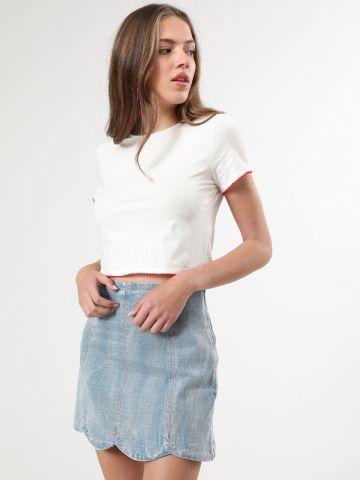 חצאית ג'ינס מיני ווש עם סיומת גלית