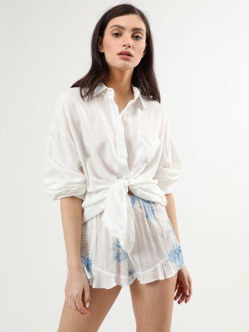 מכנסיים קצרים בהדפס עלים עם סיומת מלמלה