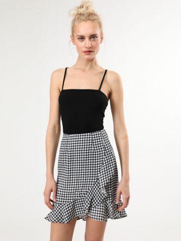 חצאית משבצות מיני עם סיומת פפלום אסימטרית