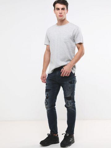 ג'ינס ארוך עם קרעים