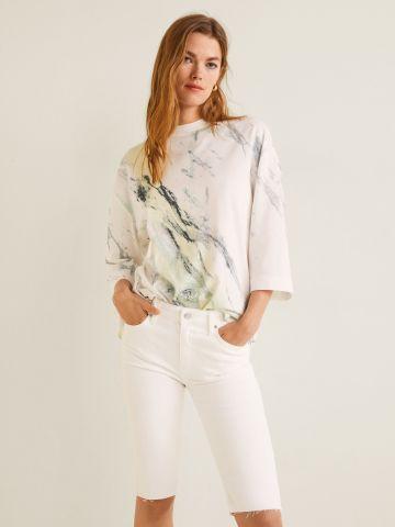 ג'ינס סקיני קצר עם סיומת פרומה