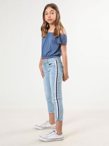 ג'ינס עם קרעים וסטריפים לורקס