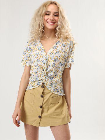 מכנסי חצאית קצרים עם כפתורים בחזית
