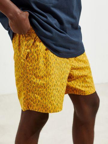 מכנסי בגד ים קצרים בהדפס עיניים UO