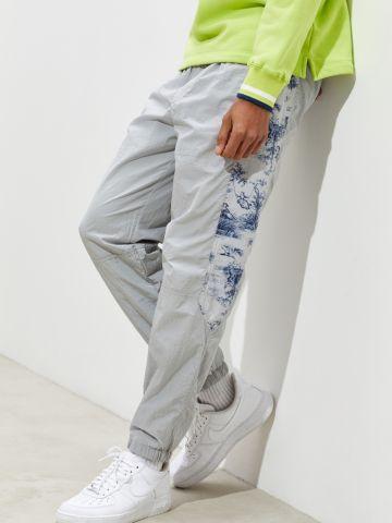 מכנסי ניילון עם פאנלים פרחים UO