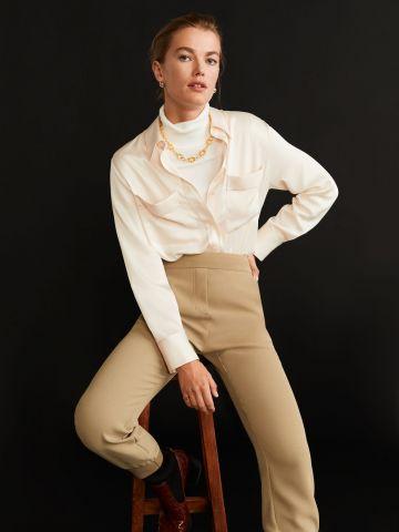 מכנסיים ארוכים עם מנג'טים בסיומת / נשים