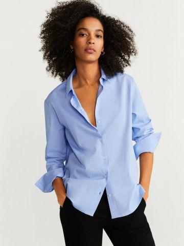 חולצה מכופתרת עם סיומת אסימטרית / נשים