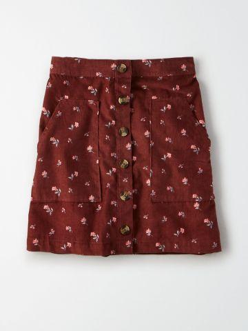 חצאית מיני בהדפס פרחים עם כפתורים / נשים