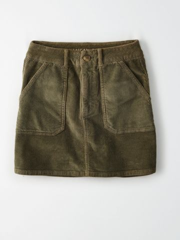 חצאית מיני קורדורוי עם כיסים / נשים