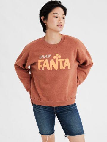 סווטשירט קרופ עם הדפס Enjoy Fanta