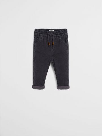ג'ינס סטרץ' עם קיפולים בסיומת / 9M-4Y
