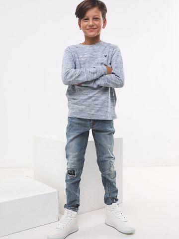 ג'ינס סקיני בשטיפה בהירה עם קרעים