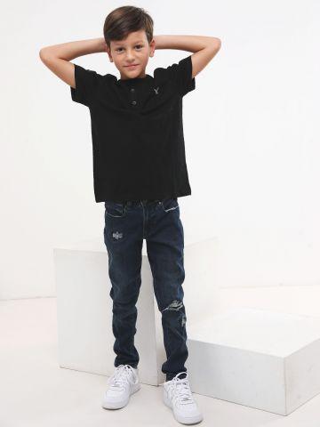 ג'ינס סקיני סטרץ' עם קרעים בשטיפה כהה