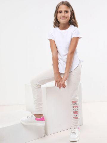 מכנסי טרנינג מלאנז' עם הדפס לוגו