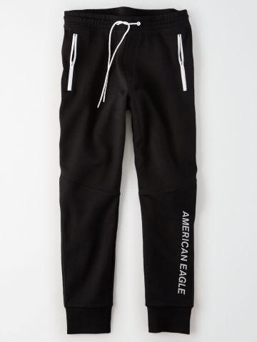 מכנסי טרנינג ארוכים עם הדפס לוגו / גברים