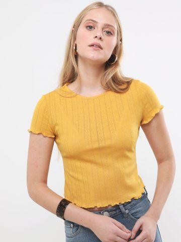 חולצת קרופ עם סיומת גלית