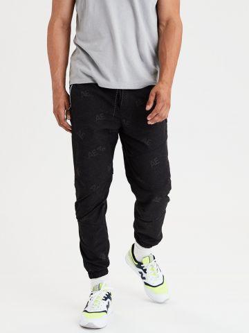 מכנסי ניילון בהדפס לוגו