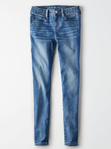 ג'ינס סקיני סטרץ' בעיטור ניטים / נשים