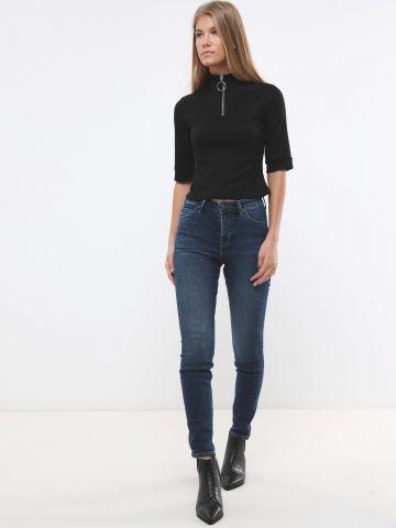 ג'ינס סקיני בגזרה גבוהה עם הבהרה עדינה
