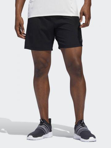 מכנסי ריצה קצרים בדוגמת משבצות עם לוגו