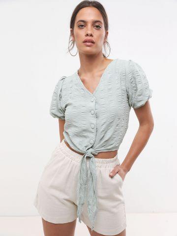 חולצת קרופ קשירה עם כפתורים