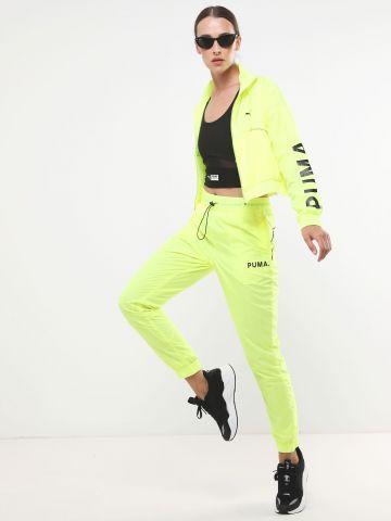 מכנסי ניילון ניאון עם לוגו