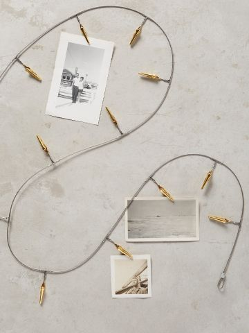 מתלה תמונות עם קליפסים מטאליים