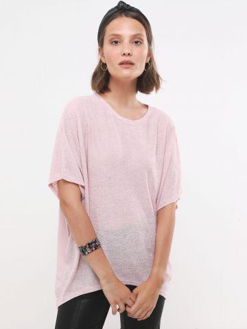 חולצת אוברסייז אסימטרית בדוגמת עלים