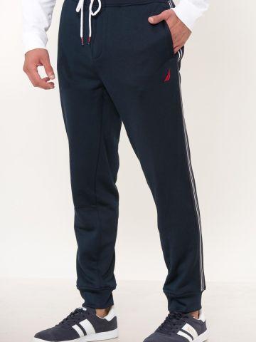 מכנסי טרנינג פוטר עם סטריפים ולוגו