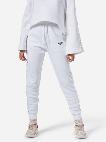 מכנסי טרנינג ארוכים עם סטריפים בהדפס לוגו רץ