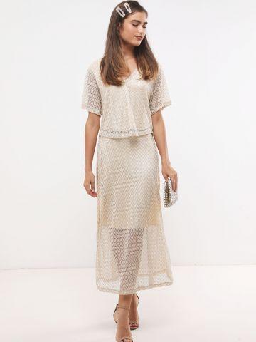 חצאית מקסי סרוגה בגוון מוזהב