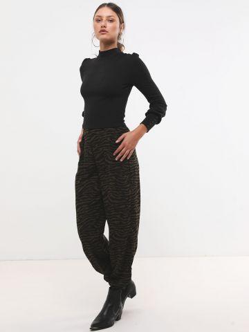 מכנסיים ארוכים בהדפס זברה עם גומי בסיומות