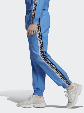 מכנסי ניילון ארוכים עם סטריפים לוגו