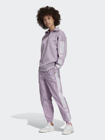 מכנסי טראק עם סטריפים לוגו