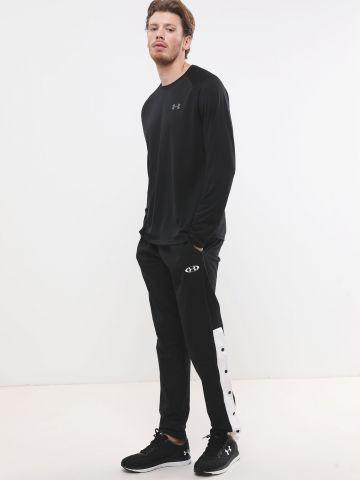 מכנסי טרנינג ניילון עם לוגו וסטריפים