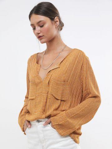 חולצת אוברסייז בהדפס פסים עם כיסים