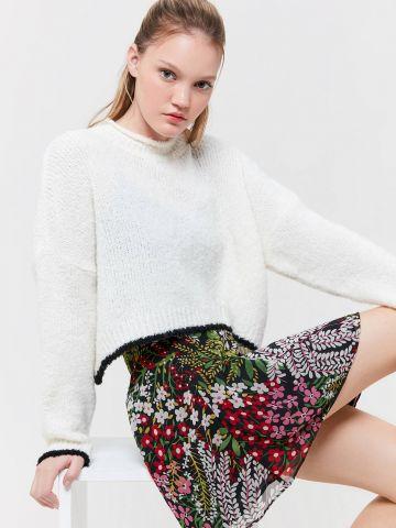 חצאית מיני גזרה גבוהה בהדפס פרחים UO