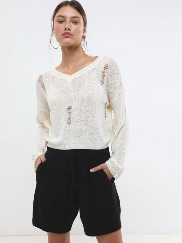 מכנסי סוודר קצרים עם כיסים