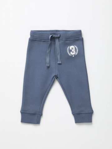 מכנסי טרנינג עם הדפס Champs /6M-5Y