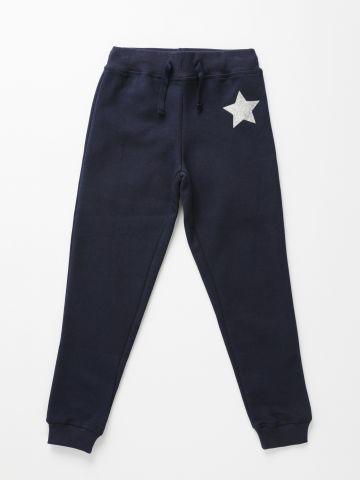מכנסי טרנינג פוטר עם כוכב נצנצים / בנות