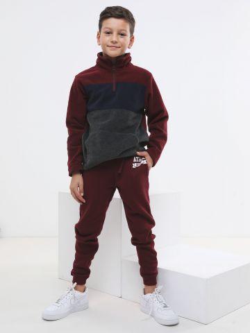 מכנסי טרנינג פוטר עם הדפס