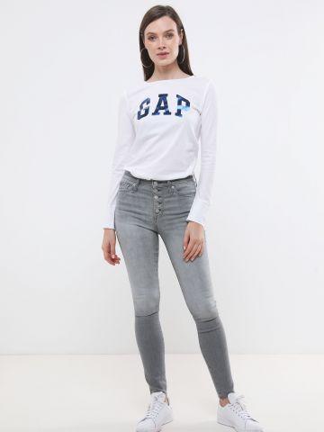 ג'ינס סקיני סטרץ' בגזרה גבוהה עם סיומת גזורה